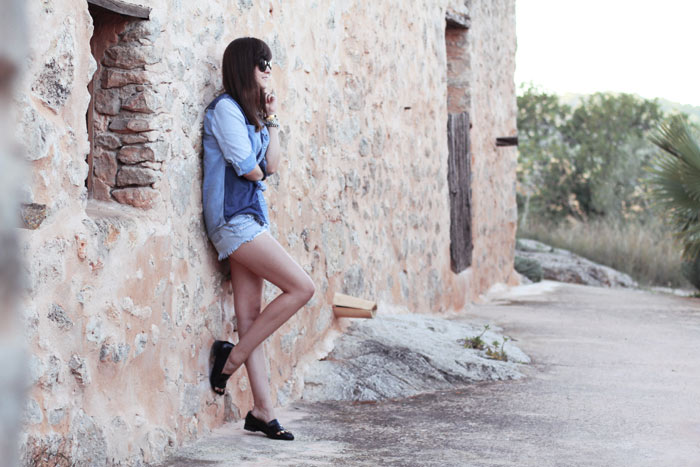 Fashion blogger Andy Torres from StyleScrapbook in Ibiza wearing a denim shirt