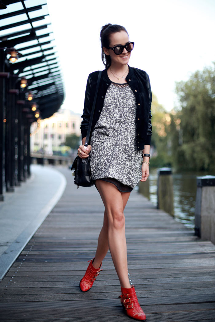 Andy Torres wearing an ACNE dress and Chloe boots