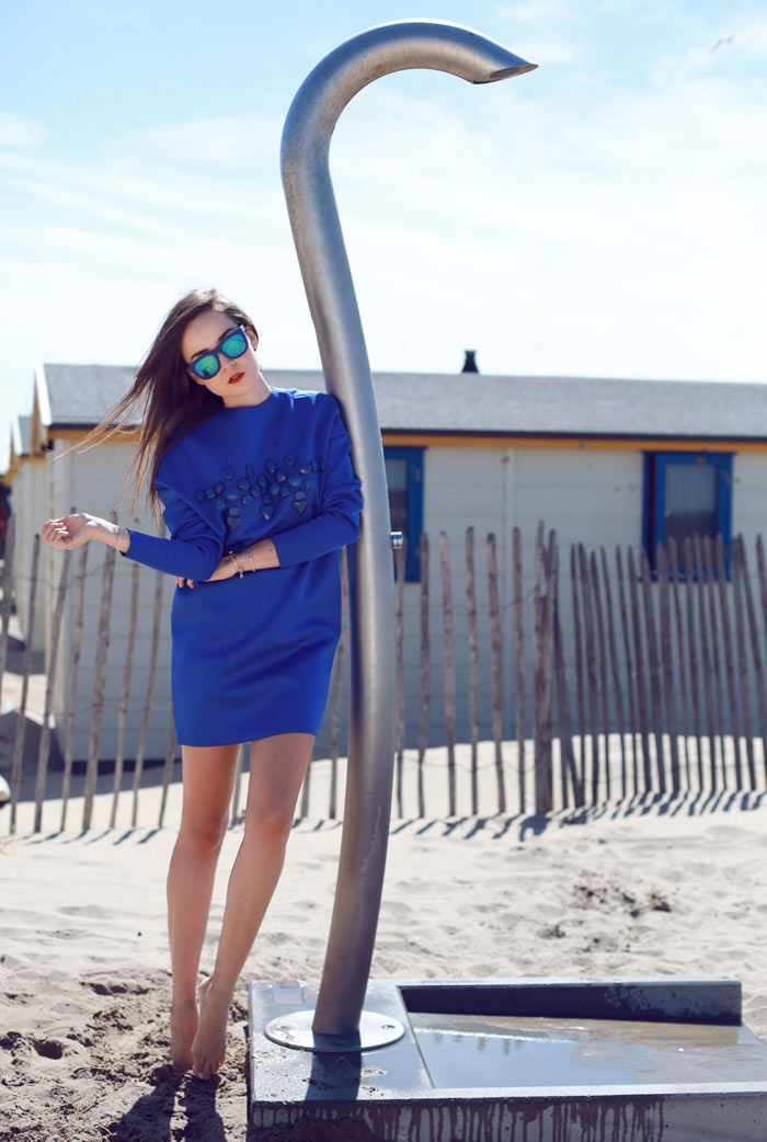 Andy Torres wearing a blue neoprene dress