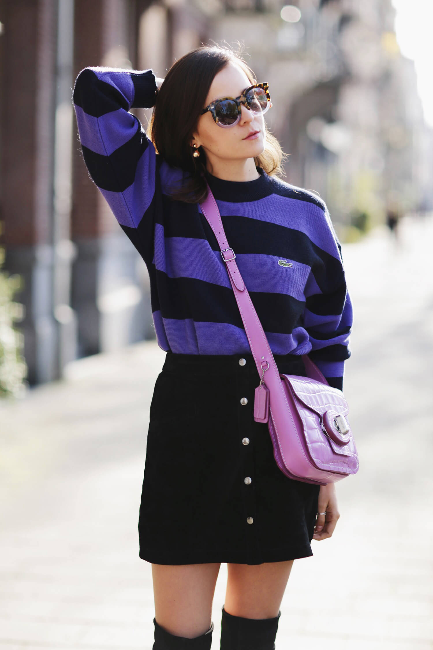 Fashion Blogger and IT girl Andy Torres from StyleScrapbook in Amsterdam wearing a vintage Lacoste sweater, pink Coach handbag, Karen Walker sunglasses, H&M Studio boots