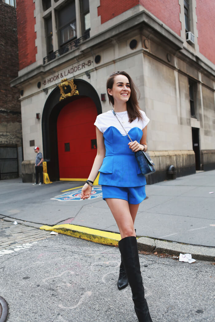 Fashion blogger and IT girl Andy Torres from StyleScrapbook with the Ghostbusters fire station behind her