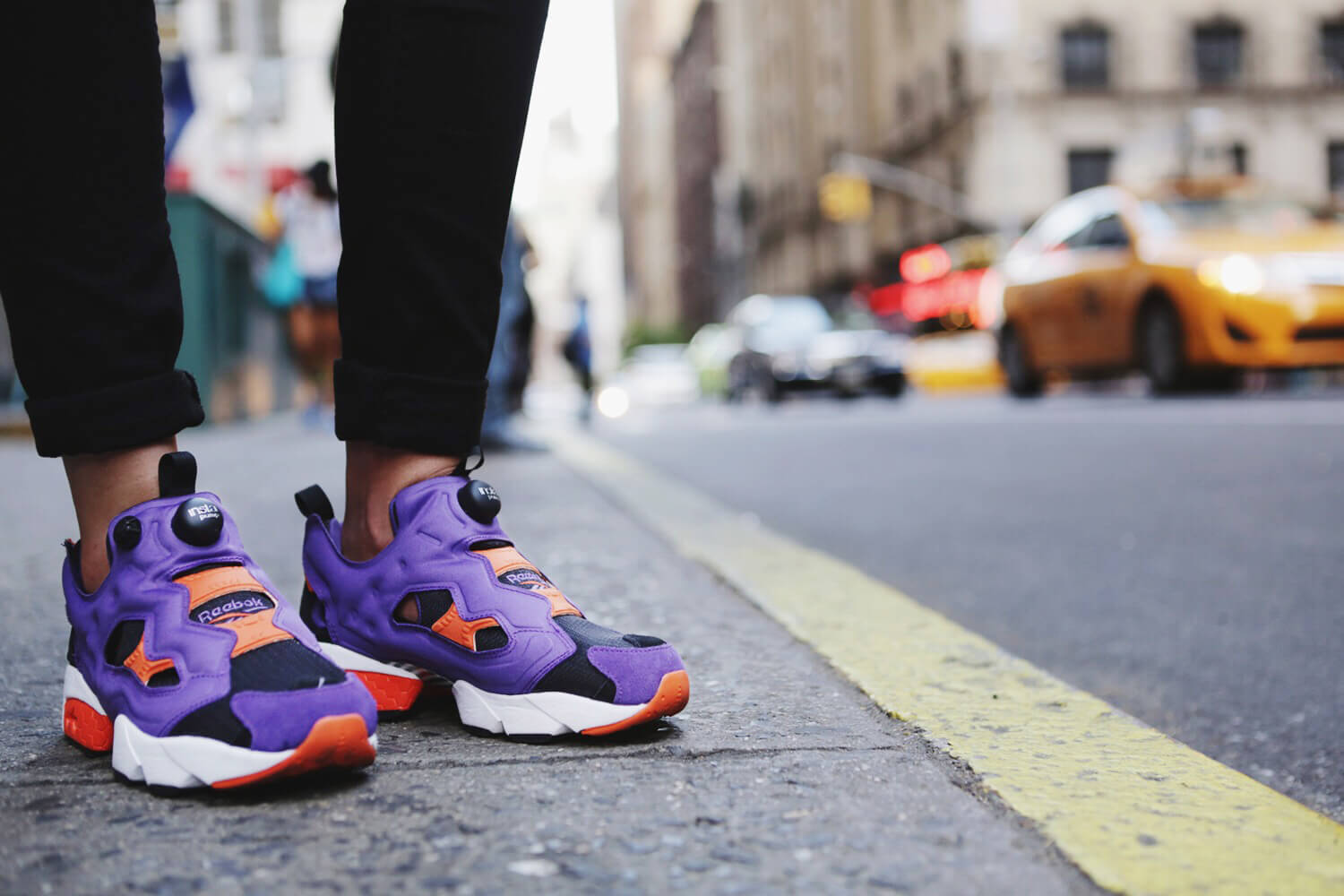 Fashion Blogger Andy Torres wearing Reebok insta pump sneakers in New York City