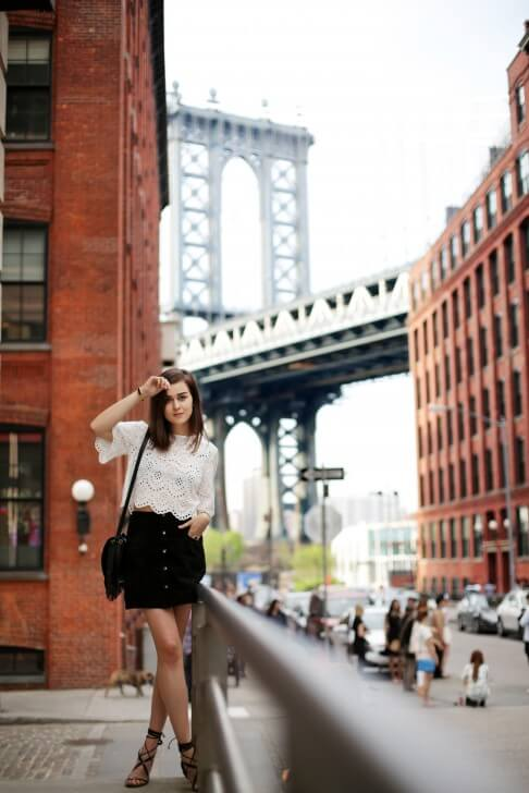 Fashion Blogger Andy Torres at Dumbo in Brooklyn wearing gladiator sandals from Mango, a crochet top from Zara and a bag from Meli Melo