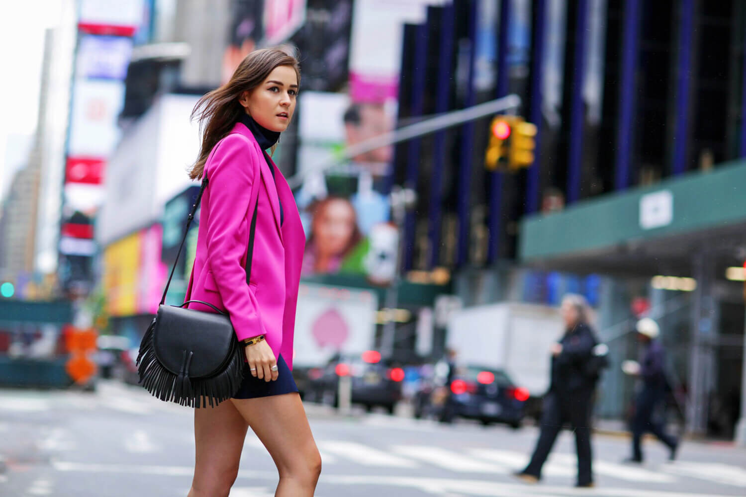 Andy Torres in Times Square wearing pink Sportmax blazer and senso shoes